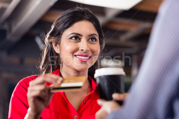 Female Customer paying for coffee with credit card Stock photo © Kzenon