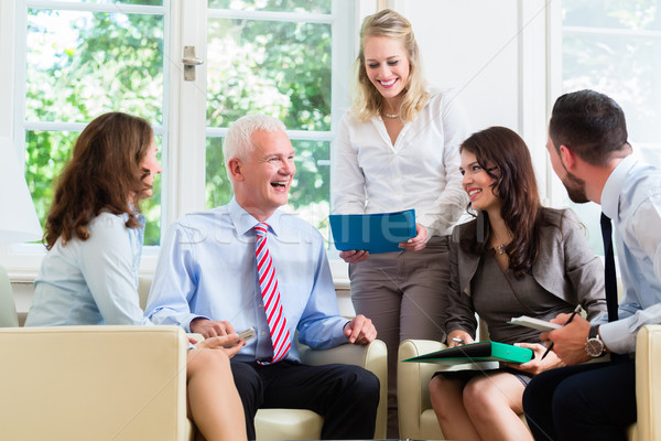 Business women and men having presentation in office Stock photo © Kzenon