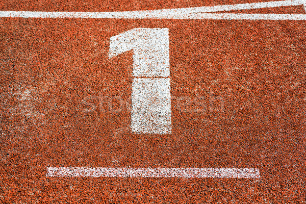 Start number one at cinder track of track and field running trac Stock photo © Kzenon