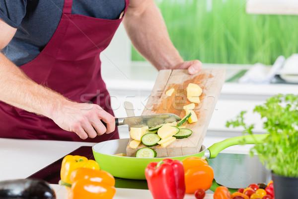 Man preparing food for cooking in kitchen Stock photo © Kzenon