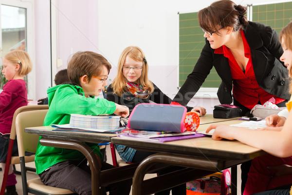Education - Pupils and teacher learning at school Stock photo © Kzenon