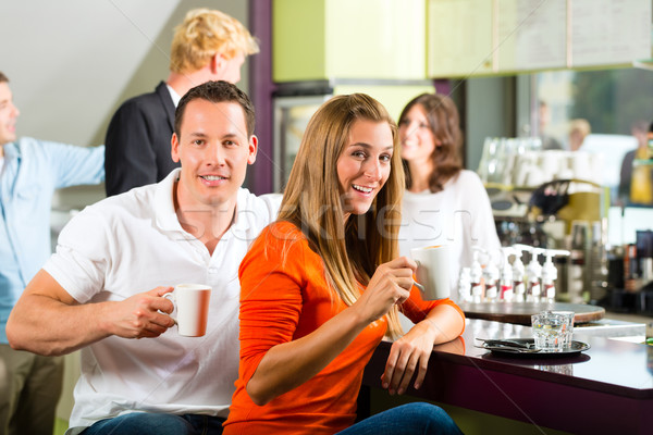 Group of people in Cafe drinking coffee Stock photo © Kzenon