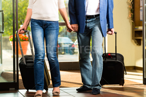 Senior married couple arriving at Hotel Stock photo © Kzenon