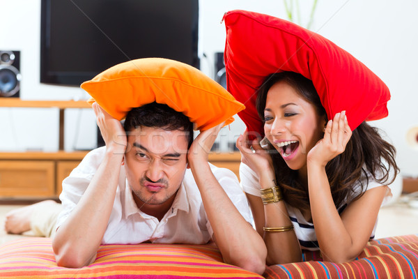 Asian couple at home in their living room Stock photo © Kzenon
