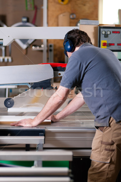 Carpenter using electric saw Stock photo © Kzenon