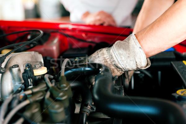 Car mechanic in repair shop Stock photo © Kzenon