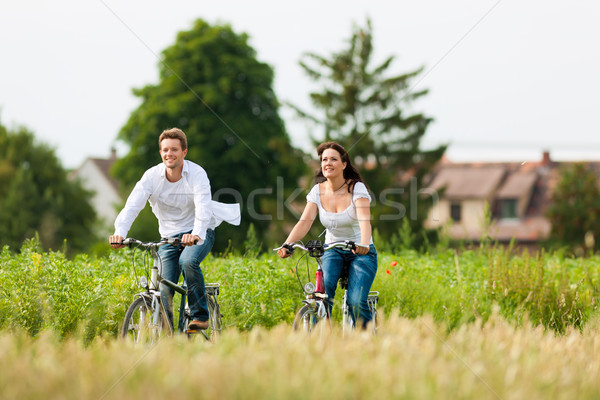 Man and woman cycling in summer Stock photo © Kzenon
