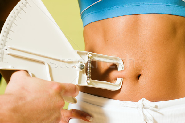 Measuring body fat Stock photo © Kzenon
