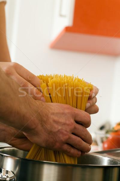 Pasta cooking in a pot Stock photo © Kzenon