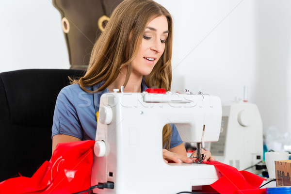 Fashion designer or tailor working in studio Stock photo © Kzenon