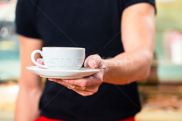 Waiter working in ice cream cafe Stock photo © Kzenon