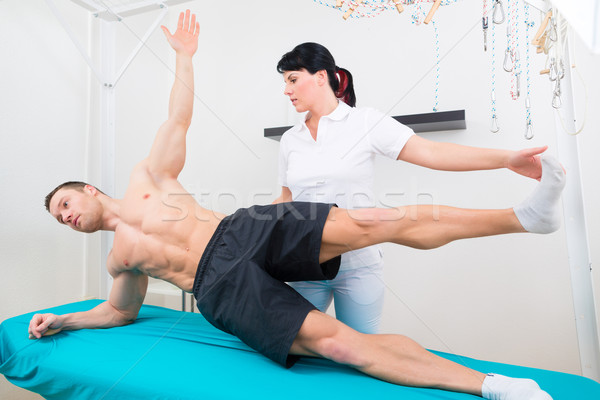 Physiotherapist exercising with patient in practice  Stock photo © Kzenon