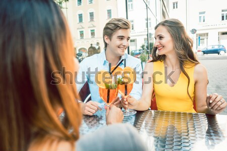 Chinese couples drinking cocktails in hotel pool bar Stock photo © Kzenon