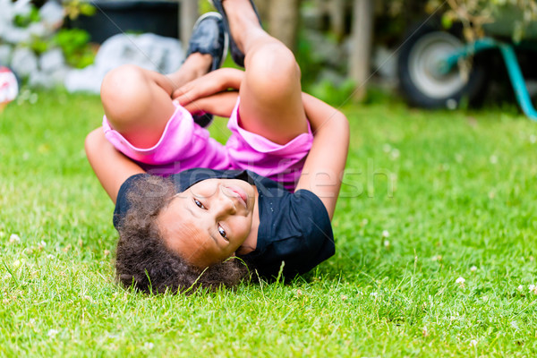 African girl playing on meadow  Stock photo © Kzenon