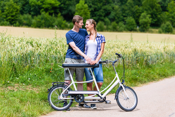 Couple riding tandem bike together in the country Stock photo © Kzenon