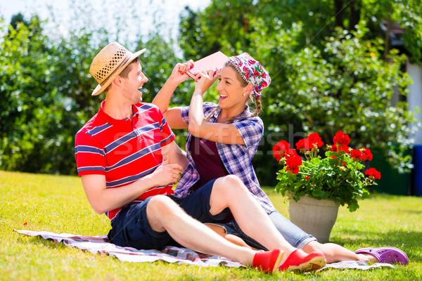 Couple having argument in garden Stock photo © Kzenon