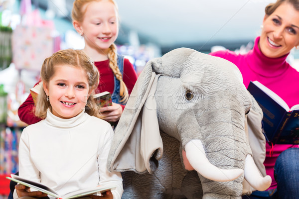 Mother with two kids shopping in toy store Stock photo © Kzenon
