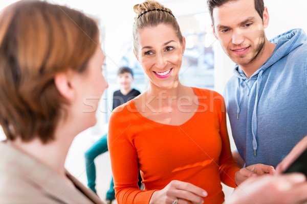 Family and realtor looking at apartment floor plan Stock photo © Kzenon