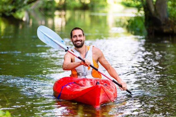 Man rijden kajak bos rivier sport Stockfoto © Kzenon