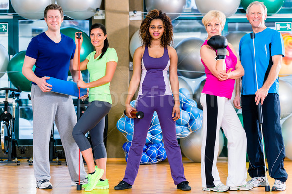 Diversity group in gym doing sport in gymnastic training Stock photo © Kzenon