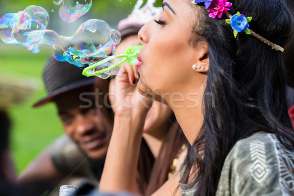 Indian girl blowing soap bubbles Stock photo © Kzenon