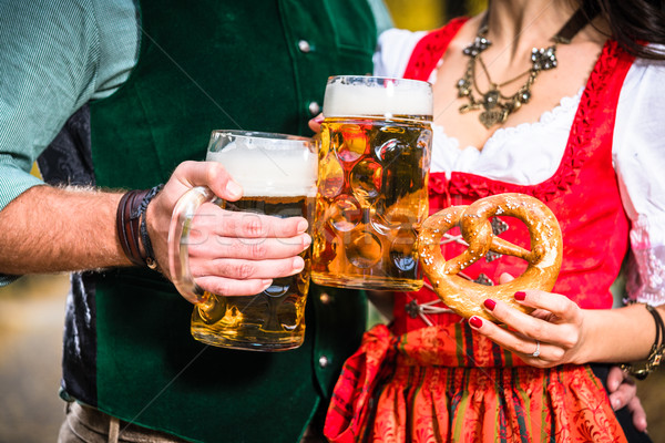 Hands holding Beer and Pretzels, detail of bavarian Tracht  Stock photo © Kzenon