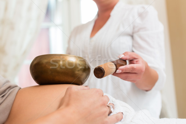 Pregnant woman getting sound bowl treatment Stock photo © Kzenon