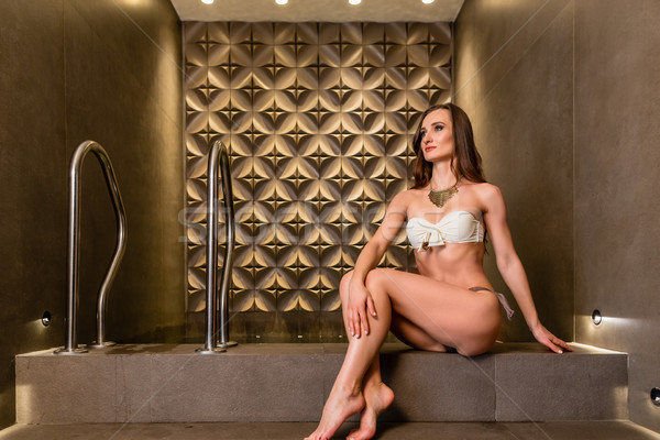 Beautiful young woman daydreaming in a luxury wellness center Stock photo © Kzenon