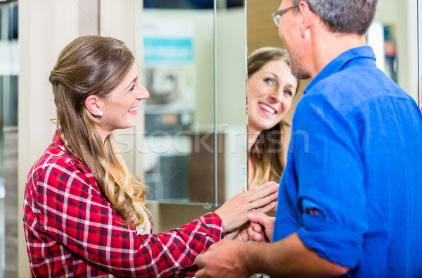 Shop assistant in hardware store counseling customer Stock photo © Kzenon