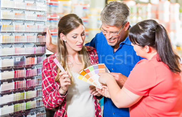 Home improvement store clerk counseling customers Stock photo © Kzenon