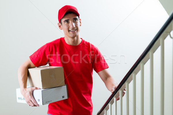 Fast delivery male courier with two boxes Stock photo © Kzenon