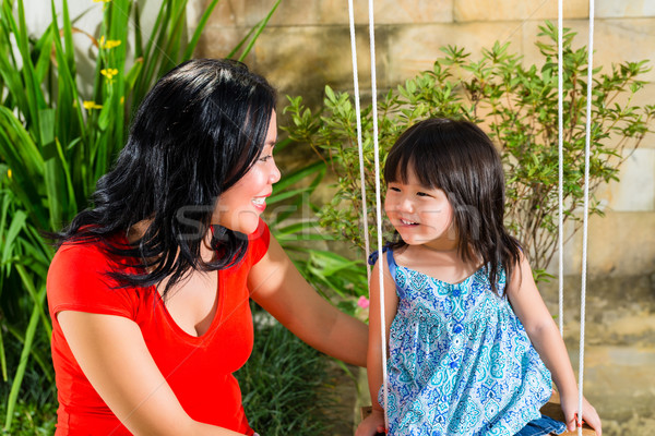 Asian Mother and daughter at home in garden Stock photo © Kzenon