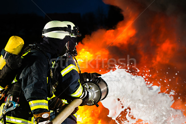 Firefighter - Firemen extinguishing a large blaze Stock photo © Kzenon