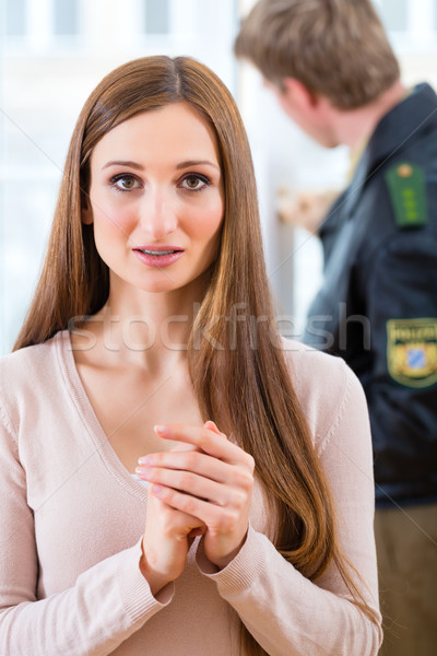 Police officer preserving evidence after burglary Stock photo © Kzenon