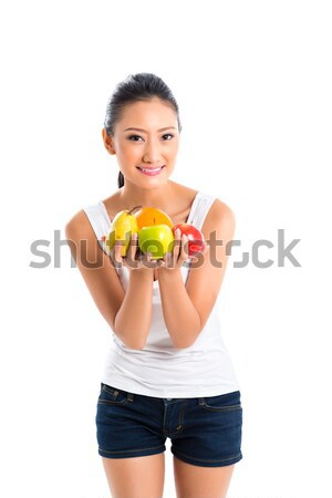 Asian woman offering healthy fruits  Stock photo © Kzenon