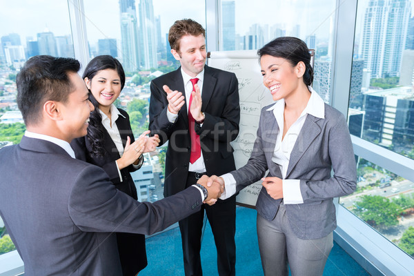 Business team applause in meeting Stock photo © Kzenon