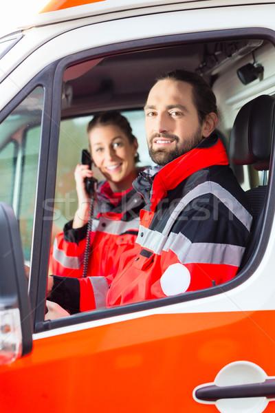 Emergency doctor driving in ambulance   Stock photo © Kzenon