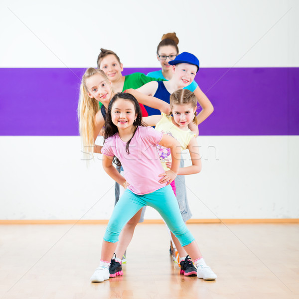 Kids train Zumba fitness in dancing school  Stock photo © Kzenon