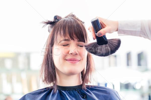 Hairdresser cutting woman hair in shop Stock photo © Kzenon