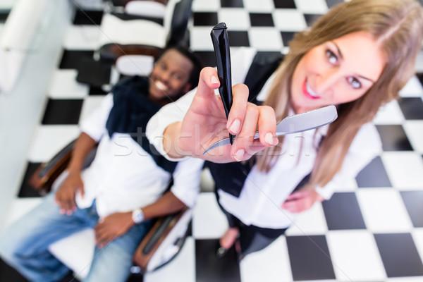 Fodrász pózol borotva tart nő férfi Stock fotó © Kzenon