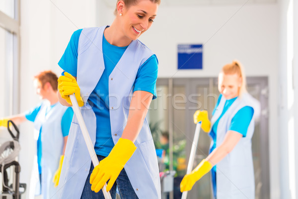 Commercial cleaning brigade working Stock photo © Kzenon