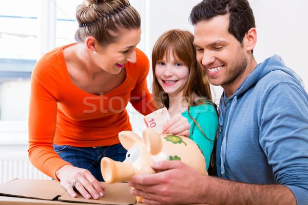 Family saving money by moving house Stock photo © Kzenon