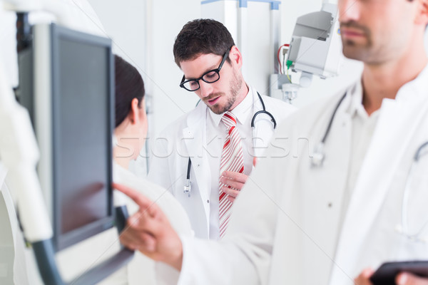 Doctor diagnosing at screen after MRI scan in hospital Stock photo © Kzenon