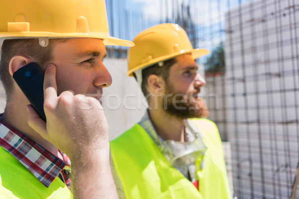Worker talking on mobile phone during work on the construction s Stock photo © Kzenon