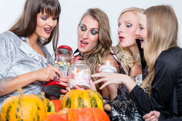 Best friends sharing candies while celebrating Halloween at cost Stock photo © Kzenon