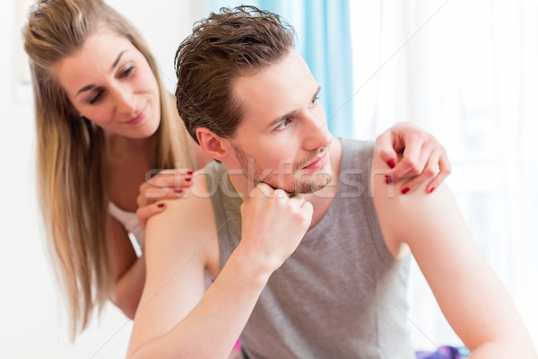 Arguing young couple, man is huffy and remains silent Stock photo © Kzenon