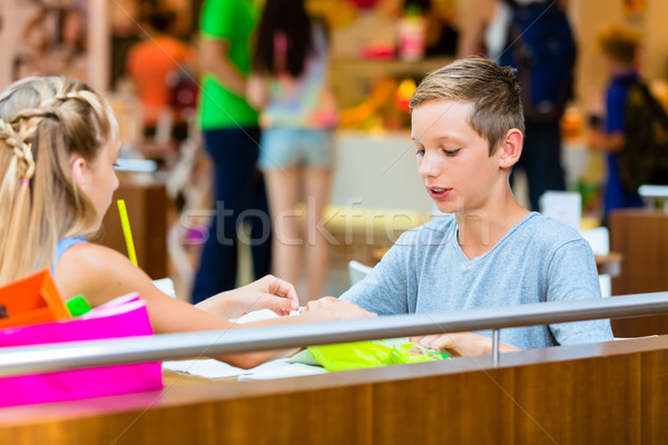 Children eating in cafe at shopping mall Stock photo © Kzenon