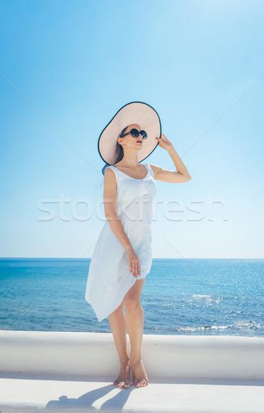 женщину солнце Греция океана пляж Сток-фото © Kzenon