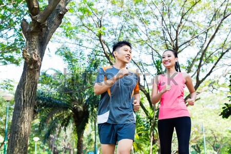 Man congratulating his girlfriend to finishing fitness exercise Stock photo © Kzenon
