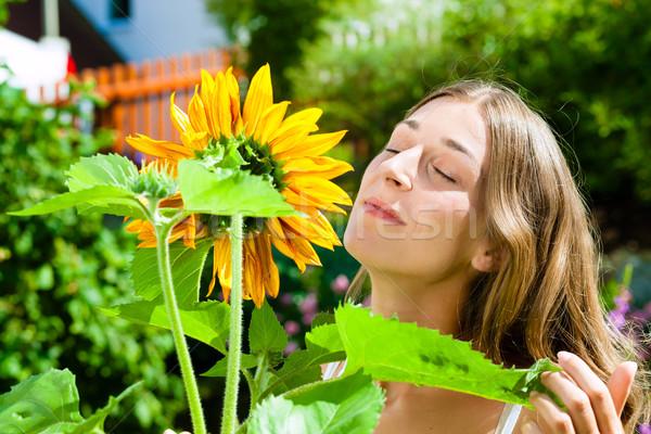 Woman standing in the garden Stock photo © Kzenon